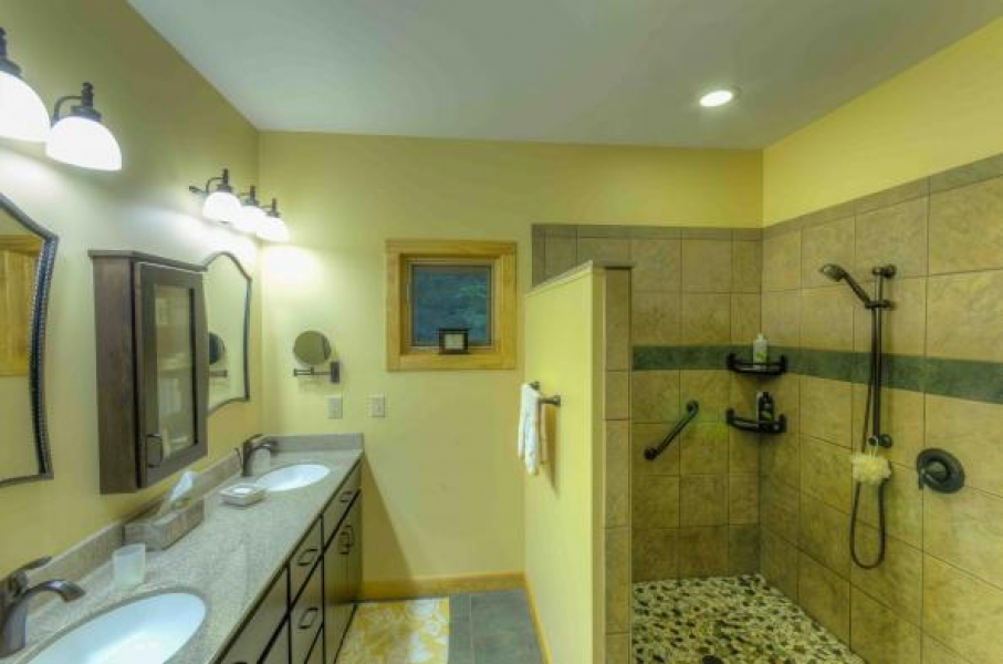 master bathroom with exciting open shower design, dual sinks