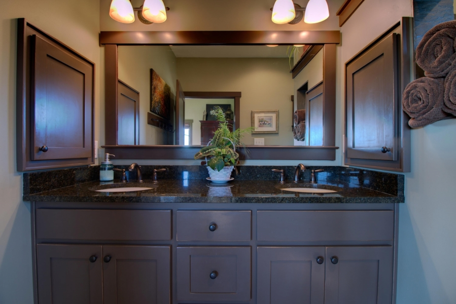master bath custom vanity cabinets, flanked by matching medicine cabinets