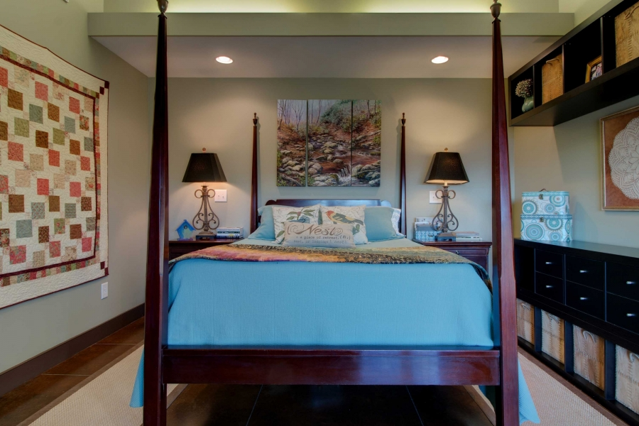 master bedroom with SIP roof panels providing cathedral ceiling; light shelf detail over the bed