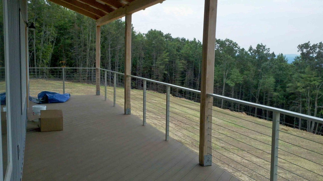 image of an open stainless steel cable railing system between white oak timber posts by Timber Ridge Craftsmen Inc near Smith Mtn Lake VA