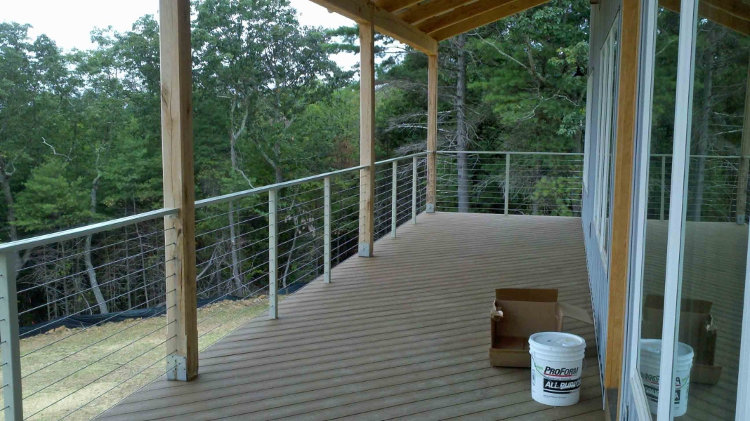 image of an open stainless steel cable railing system between white oak timber posts by Timber Ridge Craftsmen Inc near Smith Mountain Lake VA