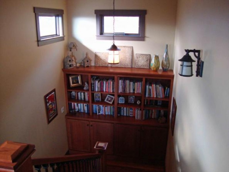 custom built-in bookshelves in staircase landing