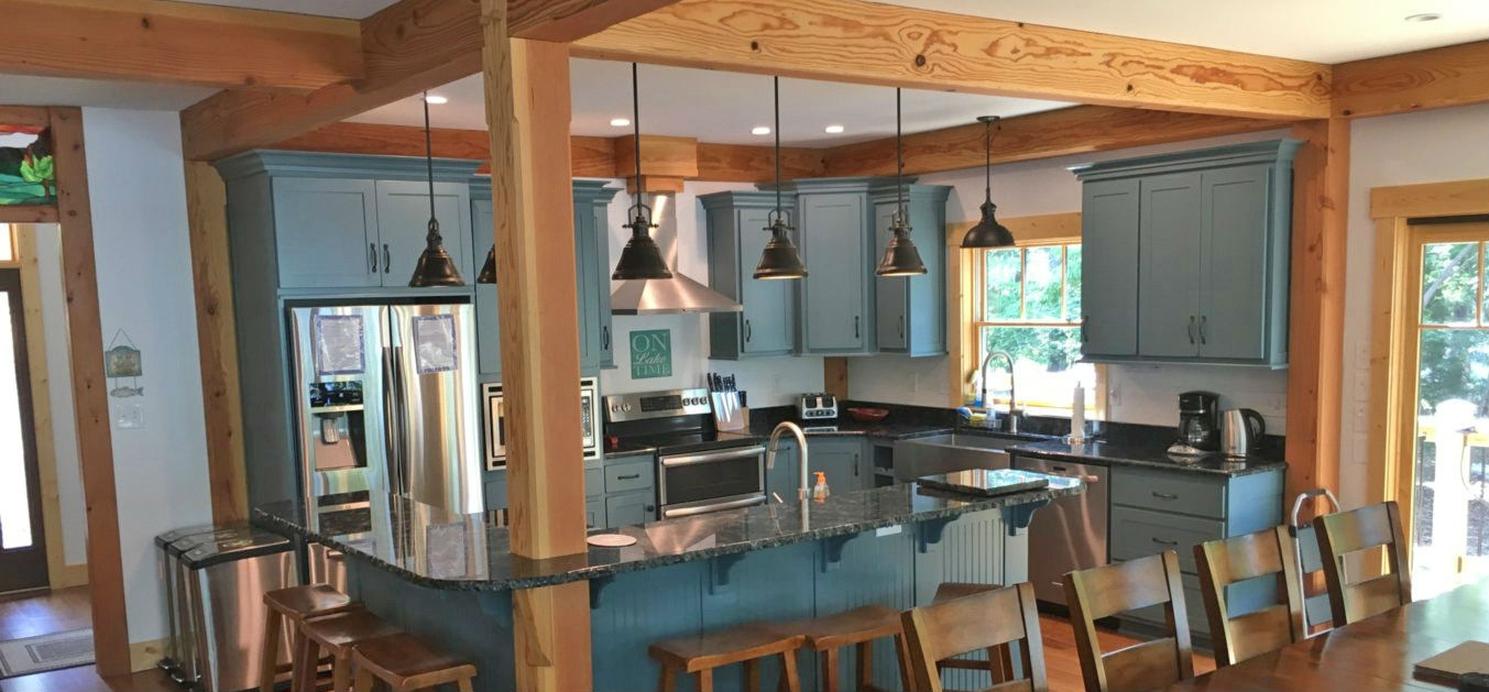 Interior Shot of Kitchen with Countertops and Hanging Lights