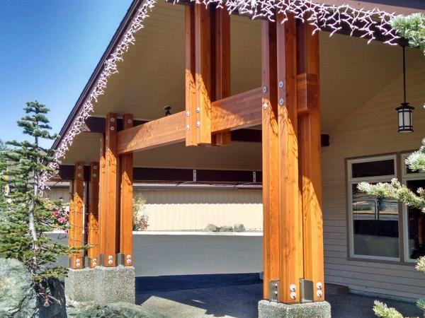 example of a post and beam porch featuring exposed metal connection plates and bolts, wood timber beam construction