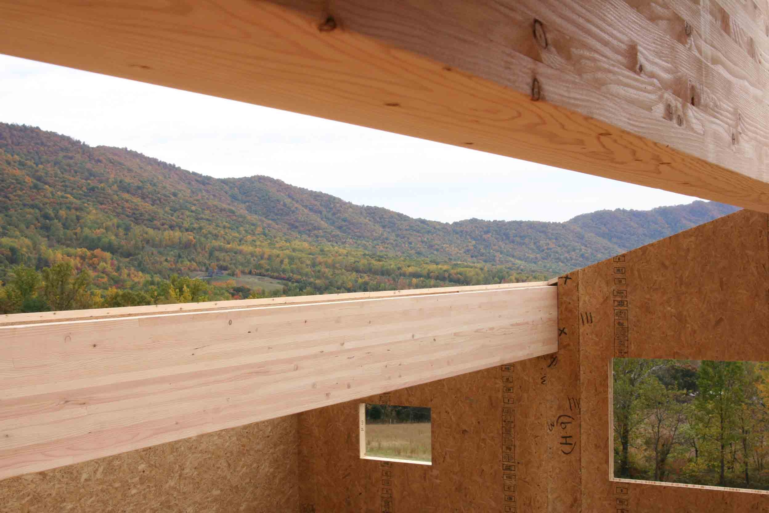 example of architectural grade douglas fir glulam beams combined with SIP panels at a Smith Mountain Lake custom home