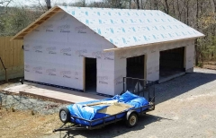 example of Typar drain wrap used to protect framed walls, and Titanium UDL underlayment on a roof
