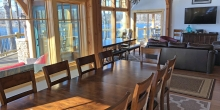 Custom dining rom with windows looking out on lake