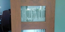 image of nature scene etched into frosted glass of a custom barn door, Smith Mountain Lake Bedford County by Timber Ridge Craftsmen Inc. in Moneta