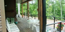 custom deck and doors looking out to the woods