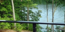 cable and steel railing on porch overlooking lake in Virginia