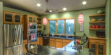 efficient kitchen with custom island in T shape, breakfast bar, for entertaining