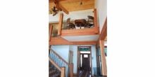 image of cantilevered balcony platform into great room of custom home Heron Point built by Timber Ridge Craftsmen Inc. on Smith Mountain Lake VA
