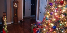living room lights and tree in timber ridge home at christmas