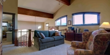 Upstairs, loft view with exposed glulam beams - Bedford County mountain home