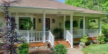 welcoming porch on the front of a house built to order