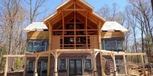 herons point timber frame custom home raising the building and deck
