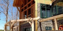 heron point construction of timber frame house with windows for a great view of the lake