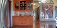 elaborated sideboard area of cabinetry adjacent to galley-style kitchen of mountain Craftsman timber home by Timber Ridge Craftsmen Inc