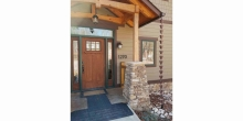 timber entry portico with stone pedestals and copper rain chan detail on custom home at Smith Mountain Lake VA, Timber Ridge Craftsmen Inc designer builder