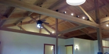 image of an open-ceiling floor plan highlighting the natural beauty of timber frame with wood tongue & groove ceiling built by Timber Ridge Craftsmen Inc near SML Virginia in the Blue Ridge Mountains